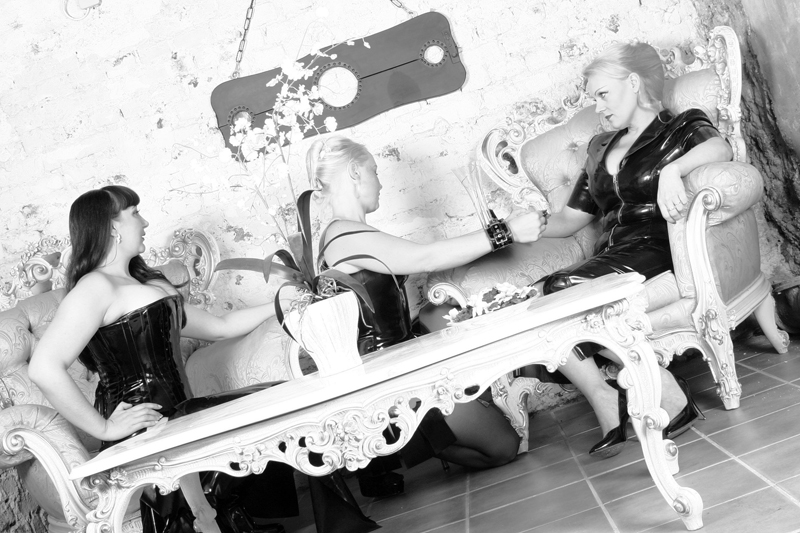 Mistress Electra Amore & Lady Riva being served by the maid. Germany August 2004
